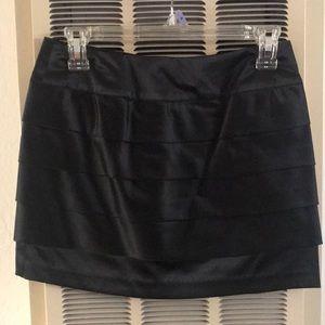 Shiny short black skirt